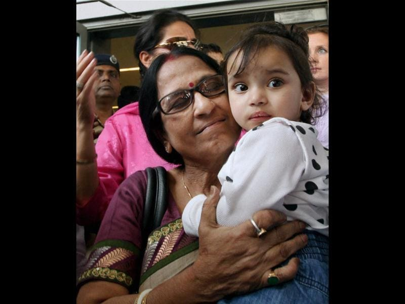 Aishwarya is carried by her grandmother on her arrival at IGI airport in New Delhi. NRI children Aishwarya and Abhigyan arrived from Norway, where they were kept in foster care for nearly a year. PTI/Atul Yadav