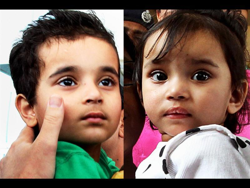 NRI children Aishwarya and Abhigyan on their arrival at IGI airport in New Delhi from Norway, where they were kept in foster care for nearly a year. PTI/Atul Yadav