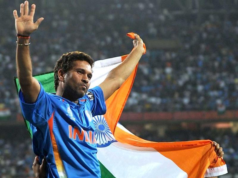 (File) Sachin Tendulkar waves the tricolour while celebrating victory during the final of ICC Cricket world Cup 2011 match between India and Sri Lanka at the Wankhede Stadium in Mumbai. Sachin Tendulkar turned 39, with an impassioned plea from his childhood coach to carry on playing cricket for India since he is