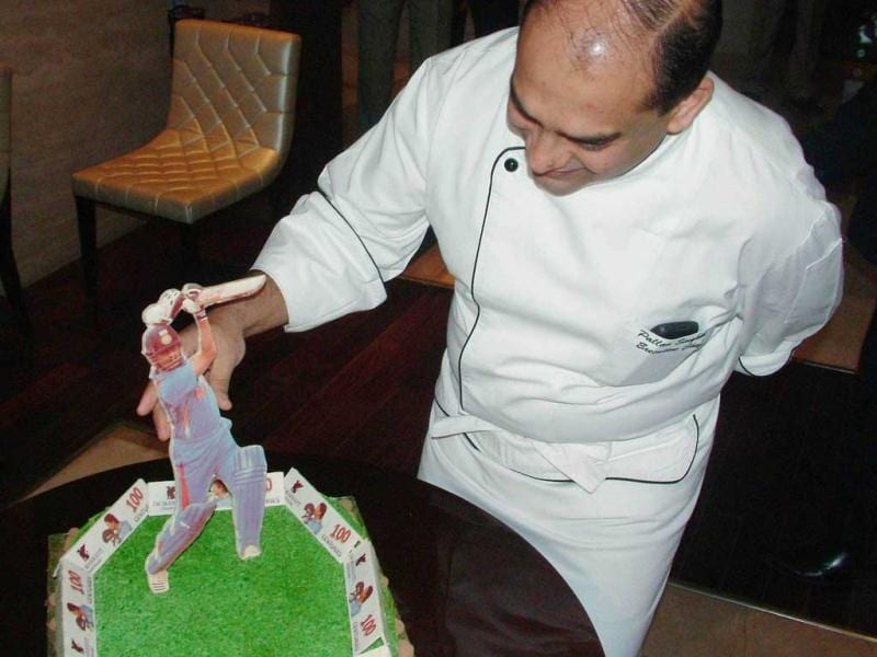 Chef Pallav Singhal with a special cake prepared by him on the 39th birthday of master blaster Sachin Tendulkar in Chandigarh.