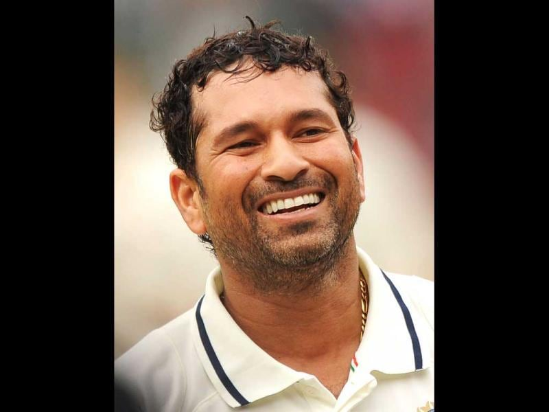 (File) Sachin Tendulkar smiles as he walks out of the ground after the second cricket Test between India and Australia at M Chinnaswamy Stadium in Bangalore. AFP/Dibyangshu Sarkar