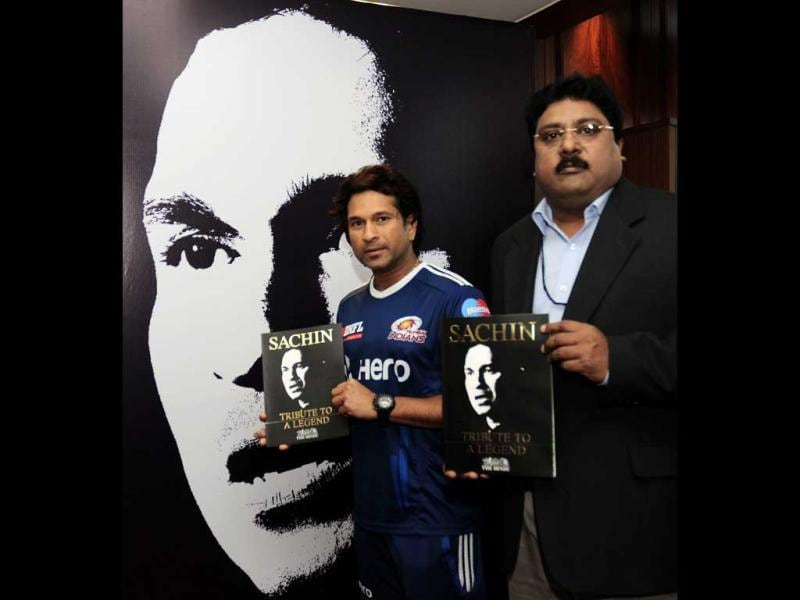 Cricket legend Sachin Tendulkar releasing a book published by The Hindu to commemorate his 100 centuries at a function in Chandigarh.