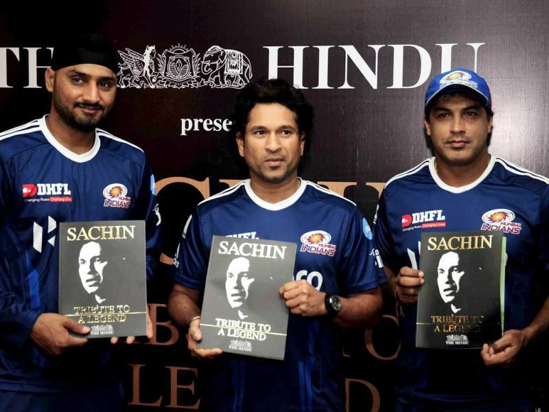 Cricket legend Sachin Tendulkar flanked by Mumbai Indians teammate Harbhajan Singh and coach Robin Singh, releases a book published by The Hindu to commemorate his 100 centuries at a function in Chandigarh, on the eve of his 24th birthday.