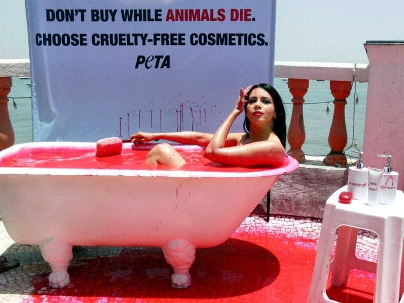 Posing for PETA, model Rozlyn Khan takes bath in blood-red water to protest against cosmetic testing on animals, in Mumbai. (PTI)