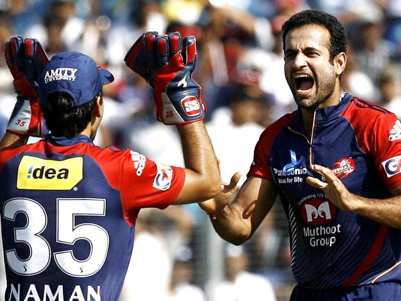 Delhi Daredevils' Irfan Pathan celebrates with wicketkeeper Naman Ojha the wicket of Pune Warriors' batsman Jesse Ryder during the IPL 5 match in Pune. (PTI PhotoShashank Parade)