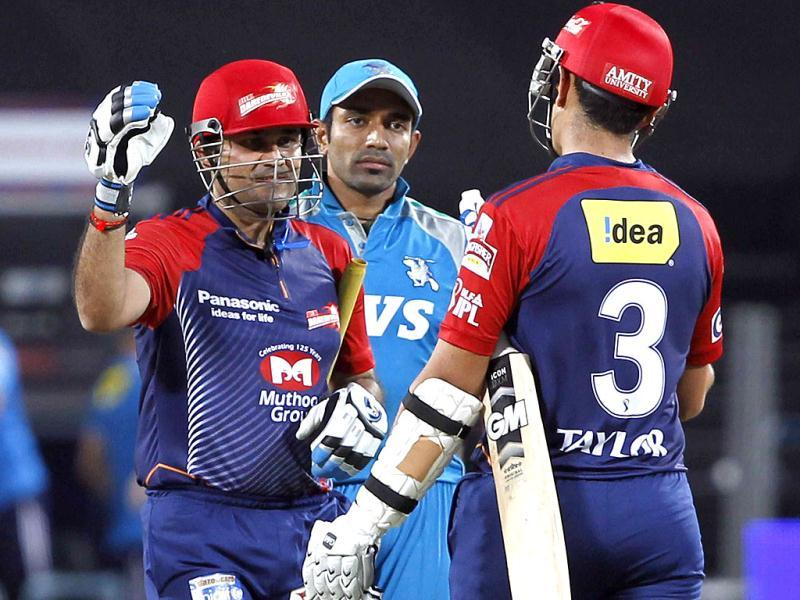 Delhi Daredavils batsman Sehwag celebrates their win with Taylor during the match between Pune Warriors and Delhi Daredavils at Subrata Roy Sahara Stadium in Pune. (HT PhotoSantosh Harhare)