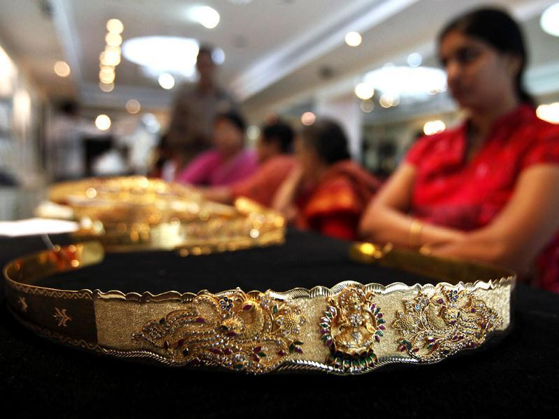 Women shop for gold ornaments at a jewelry shop in Hyderabad. The Hindu festival
