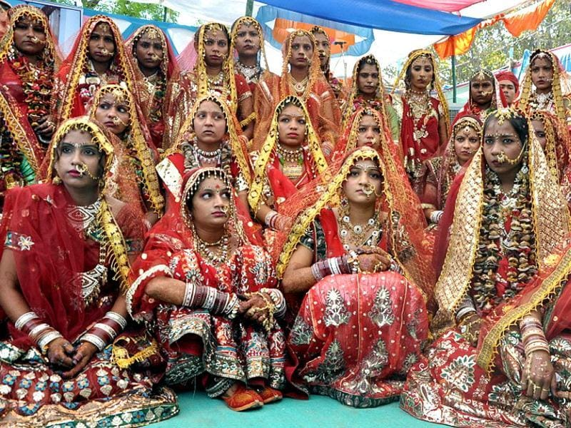 Adorned bride at a mass marriage ceremony of 105 couples of Sargar Samaj, on occasion of Akshay Tritiya in Ahmedabad. Agencies