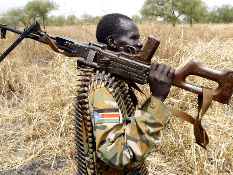 A South Sudan's army, or the SPLA, soldier holds his gun in Halop in Unity State of South Sudan. Reuters/Goran Tomasevic