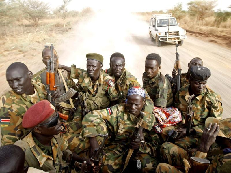 South Sudan's army, or the SPLA, soldiers drive in a truck on the frontline in Panakuach, Unity state. Reuters/Goran Tomasevic