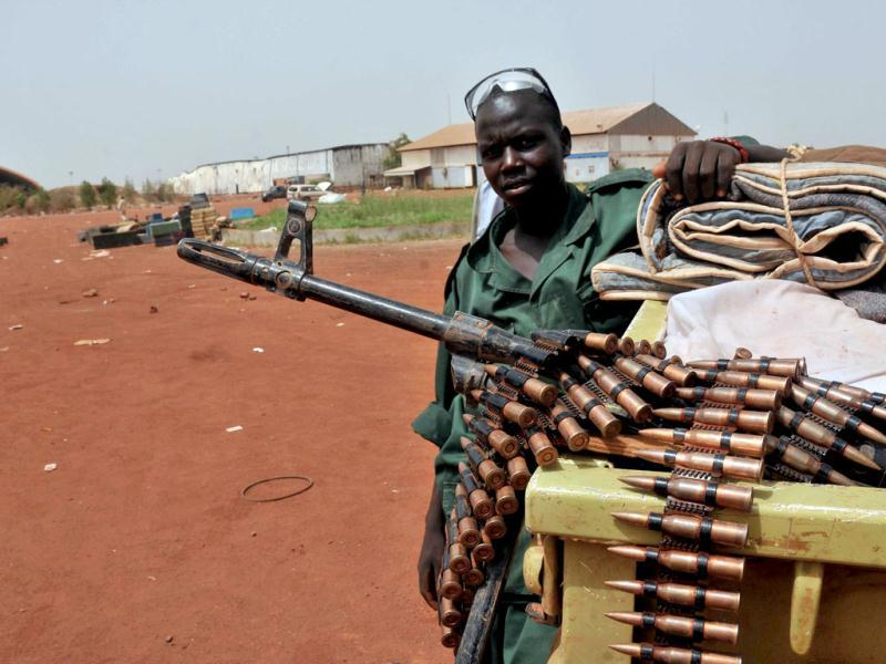 A Sudanese soldier poses next to a machine gun in the oil region of Heglig. AFP Photo/Ebrahim Hamid
