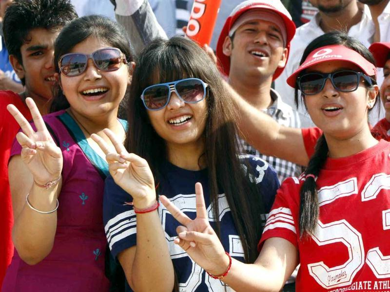 Spectators cheering the players during the DLF IPL Indian Premier league 2012 match between King's XI vs Mumbai Indian at PCA stadium, Mohali. HT Photo/Rajnish Katyal