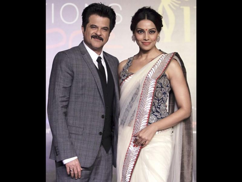 Anil Kapoor and Bipasha Basu pose for photos at a media event to announce the venue of the International Indian Film Academy (IIFA) Weekend and Awards, at a hotel in Singapore on April 24. The 13th IIFA Weekend and Awards will be held in Singapore from June 7 to June 9. (Reuters)