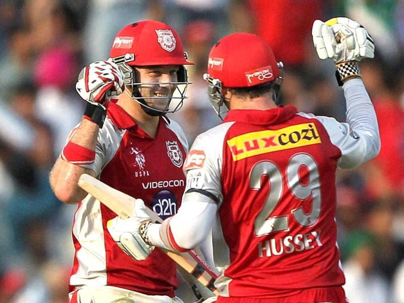 Kings XI Punjab's David Hussey and David Miller celebrate after their innings against Mumbai Indians during their IPL-5 match in Mohali. PTI Photo/Aman Sharma