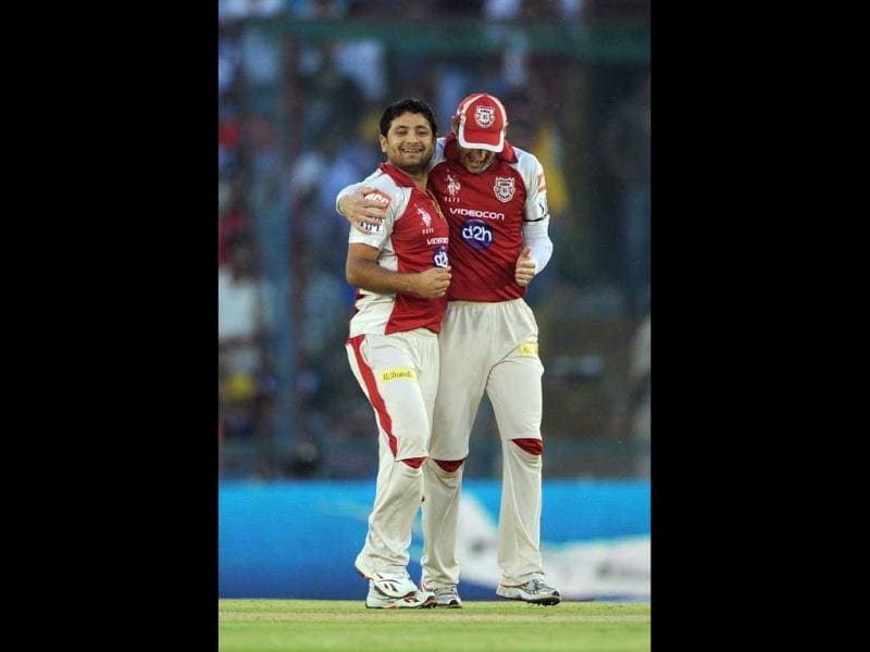Kings XI Punjab bowler Piyush Chawla (L) celebrates the wickets of Mumbai Indians Batsman Dinesh Karthik with david Hussey during the IPL Twenty20 cricket match between Kings XI Punjab and Mumbai Indians at PCA Stadium in Mohali. AFP Photo/Prakash Singh