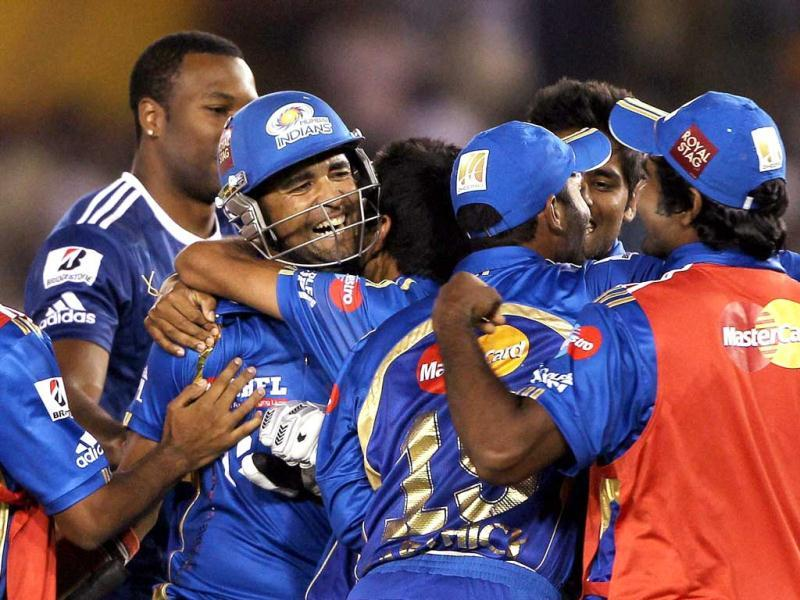 Mumbai Indians players celebrate after beating Kings XI Punjab during their IPL-5 match in Mohali. PTI Photo/Aman Sharma