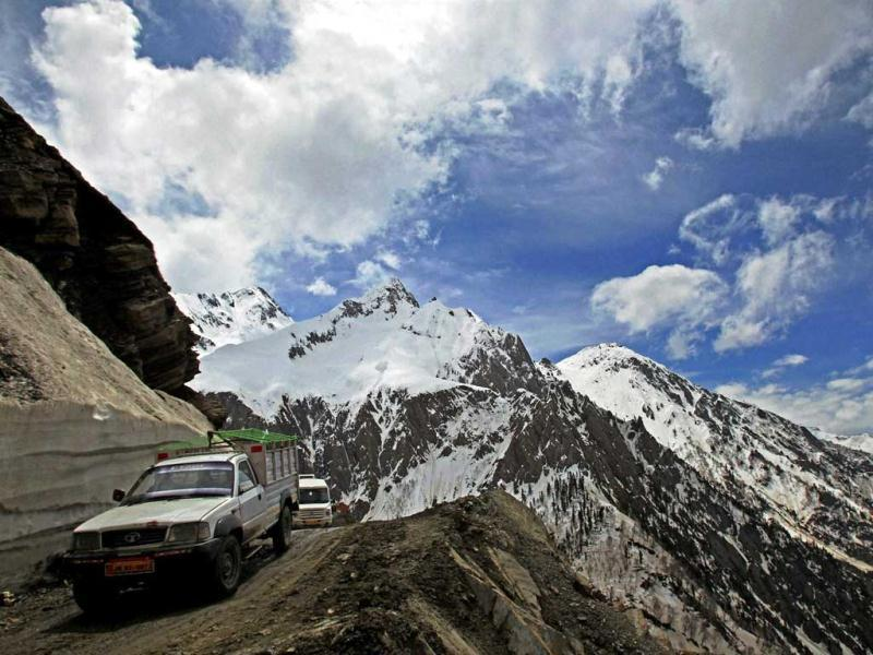 Vehicles passing through Zojila pass, situated at a height of 11,643 ft, as strategic Srinagar-Leh highway was opened for traffic after a nearly five-month winter break. PTI Photo by S Irfan