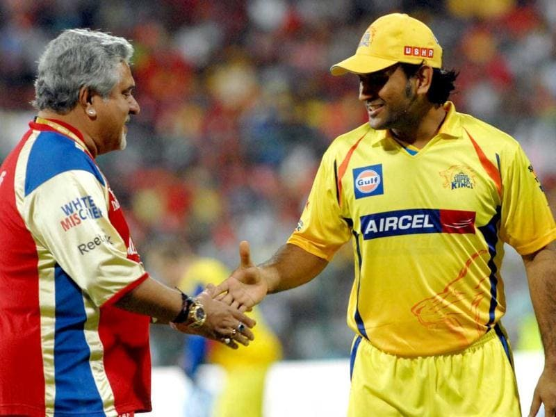 RCB owner Vijay Mallya with CSK Captain MS Dhoni before the start of the match between Royal Challengers Bangalore and Chennai Super Kings at M Chinnaswamy Stadium in Bangalore. (PTI Photo)