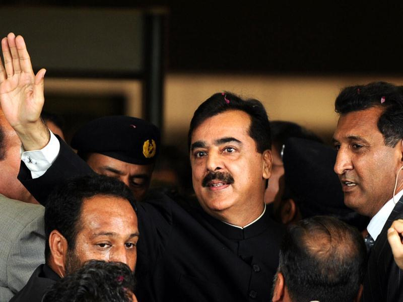 Pak PM Yousuf Raza Gilani waves upon his arrival at the Supreme Court building in Islamabad. Gilani was convicted of contempt of court by the country's highest court but avoided a jail term. AFP Photo/Aamir Qureshi