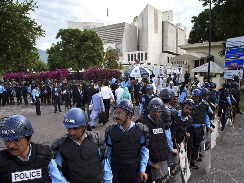 Policemen in riot-gears cordon off the Supreme court as Pak PM Yousuf Raza Gilani, unseen, appears for a hearing in Islamabad. AP Photo/BK Bangash