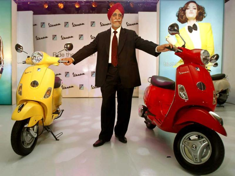 Chairman and managing director of Piaggio Vehicles Limited India Ravi Chopra poses with Vespa scooters during their launch in Mumbai. AP Photo/Rafiq Maqbool