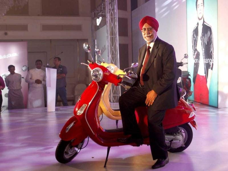 Chairman and managing director of Piaggio Vehicles Limited India Ravi Chopra poses with Vespa scooters during their launch in Mumbai. HT Photo by Kunal Patil
