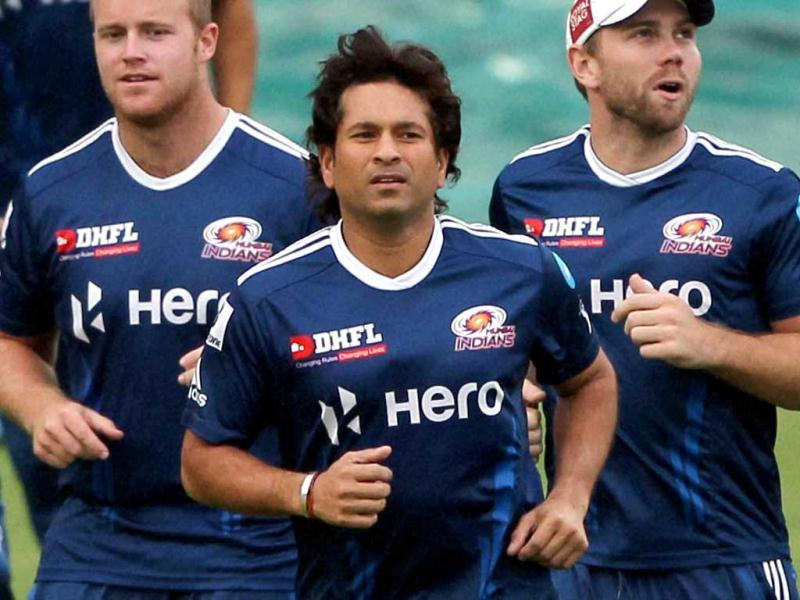 Mumbai Indians' Sachin Tendulkar jogs with teammates during a practice session a day before their IPL-5 match against Delhi Daredevils in New Delhi. PTI Photo by Aman Sharma