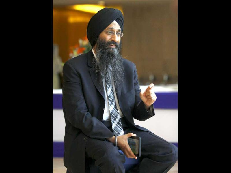 """We are committed to providing one lakh Aakash tablets to ministry of HRD and today's launch is to announce that we are honouring the bookings made by our other retail customers across India,"" Suneet Singh Tuli, chief executive officer, Datawind told HT. HT Photo/Vipin Kumar"