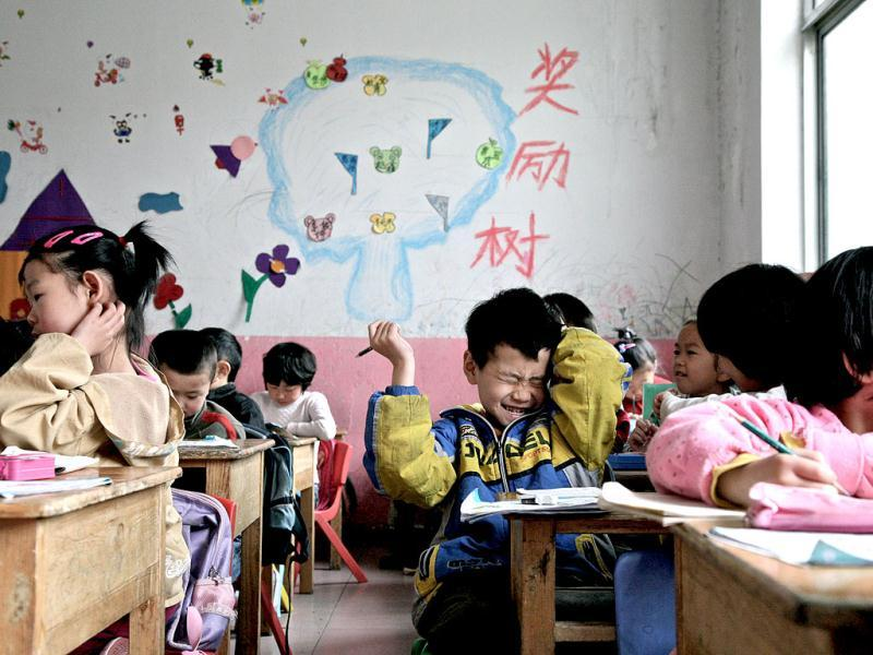 Young Chinese children attend a kindergarten set up for migrant workers, which is marked for demolition, in Beijing. AFP Photo