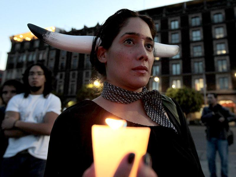 An activist from the animal rights group AnimaNaturalis holds a candle as she takes part a demonstration against bullfights, at the main Zocalo square in Mexico City. Reuters/Henry Romero