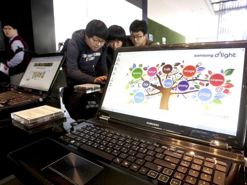 Samsung Electronics' notebook computers are displayed at its showroom in Seoul, South Korea. (AP Photo/Ahn Young-joon)