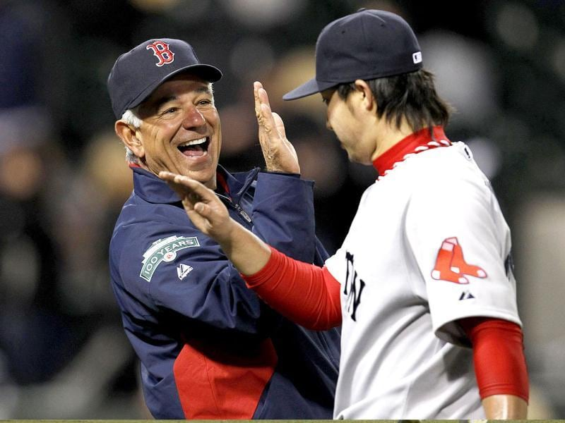 Boston Red Sox manager Bobby Valentine (L) celebrates with his relief pitcher Junichi Tazawa after they beat the Chicago White Sox 10-3 in their MLB baseball game in Chicago, Illinois. Reuters/Jeff Haynes