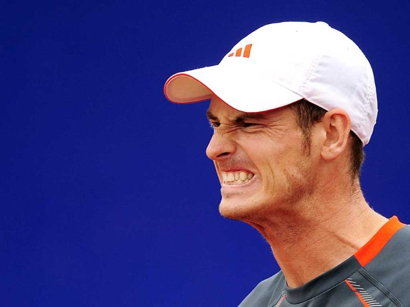 Andy Murray of Britain reacts during his match against Milos Raonic at the Barcelona open tennis in Spain. AP Photo/Manu Fernandez