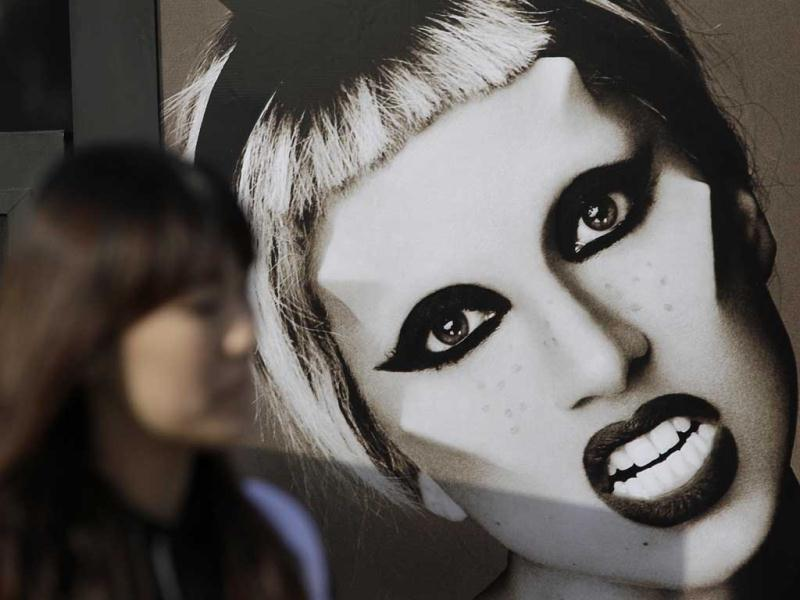 A woman walks past near the picture of US pop diva Lady Gaga before her concert in Seoul, South Korea. AP/Lee Jin-man