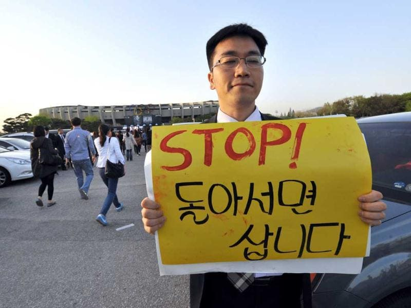 A protestor holds a placard against Lady Gaga ahead of her concert outside Seoul's Olympic Stadium. AFP/Jung Yeon-je