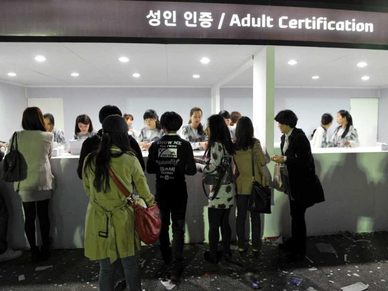 South Koreans present proof of age documents at an adult certification kiosk before attending a concert by US pop singer Lady Gaga outside Seoul's Olympic Stadium. Tens of thousands flocked to the opening show of Lady Gaga's global tour, amid colourful scenes as female and male fans donned outrageous outfits in honour of the US pop diva. AFP/Kim Jae-Hwan