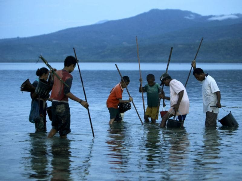 Villagers spear fish near Larantuka beach, on Indonesia's Flores island. Reuters/Beawiharta