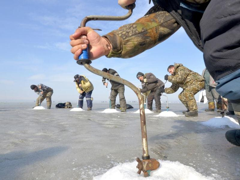 Fishermen drill ice-holes during a competition in Russia's far eastern city of Vladivostok. Reuters/Yuri Maltsev
