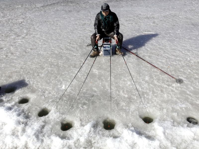 A resident fishes during an ice-fishing competition on a frozen lake in Beijing. Reuters/Jason Lee