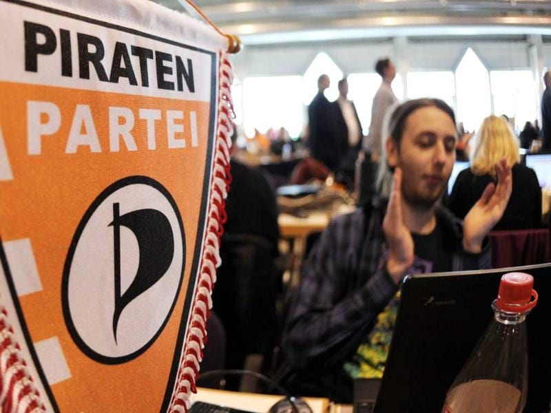 Members of German Pirate Party attend the party's two-day conference in Neumuenster, northern Germany. A new federal board of the party that flies high in the polls on a platform of Internet freedom and greater political transparency will be elected in the coming two days. AFP Photo/Angelika Warmuth