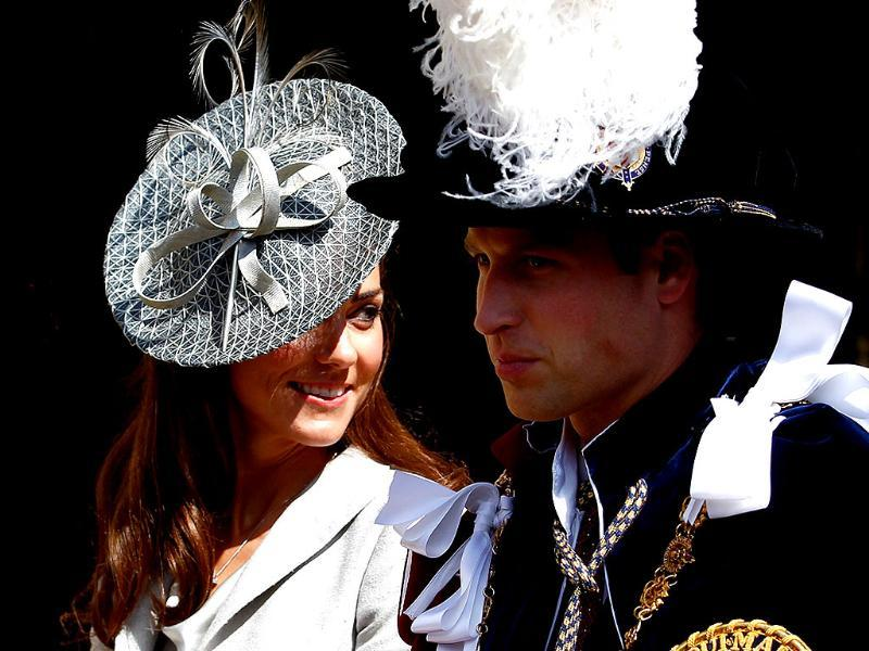 Britain's Catherine, Duchess of Cambridge (L), sits next to her husband Prince William as they leave the Order of the Garter service at St. George's chapel inside the grounds of Windsor Castle, in Windsor, southern England. (Reuters/Andrew Winning)