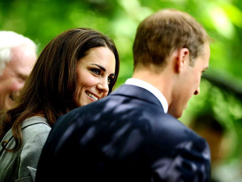 Britain's Prince William (R) and his wife Catherine, Duchess of Cambridge attend a tree planting ceremony at Rideau Hall in Ottawa. (Reuters/Lionel Hahn/POOL)