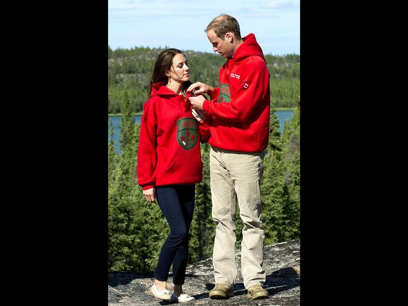 Britain's Prince William and his wife Catherine, Duchess of Cambridge, wear sweaters of the Canadian Rangers after being made honorary members during a visit to Blatchford Lake, Northwest Territories in Canada. (Reuters/Arthur Edwards/pool)