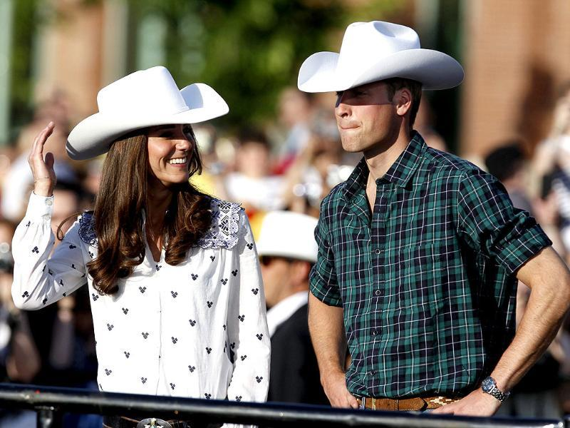 Britain's Prince William and his wife Catherine, Duchess of Cambridge, wear cowboy hats as they arrive for a Canadian government reception in Calgary, Alberta. (Reuters/Phil Noble)