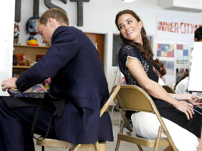 Britain's Prince William and his wife Catherine, Duchess of Cambridge, talk as they sit down to paint a picture during their tour of the Inner City Arts campus in Los Angeles, California. (Reuters/Alex Gallardo)
