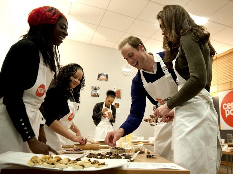 Britain's Prince William (2nd R) and his wife Catherine, Duchess of Cambridge take part in a