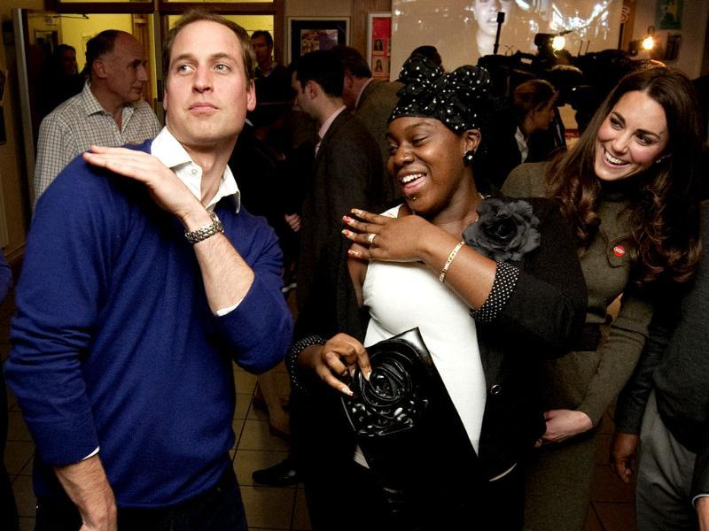 Britain's Prince William dances with Vanessa Boateng (C) as his wife Catherine, Duchess of Cambridge (R) looks on during a reception at Centrepoint's Camberwell Foyer in London. (Reuters/Ben Stansall/POOL)