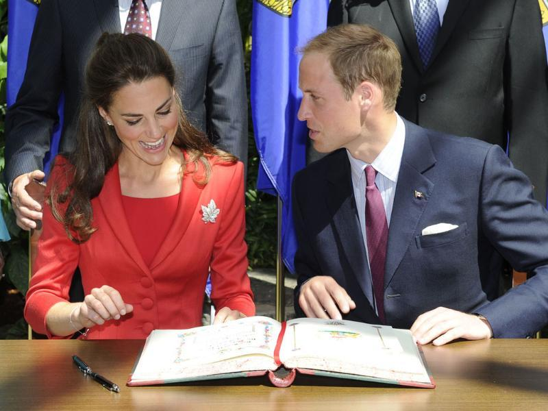 Britain's Prince William and his wife Catherine, Duchess of Cambridge, react during a signing ceremony at the Calgary Zoo in Calgary, Alberta. (Reuters/Todd Korol)