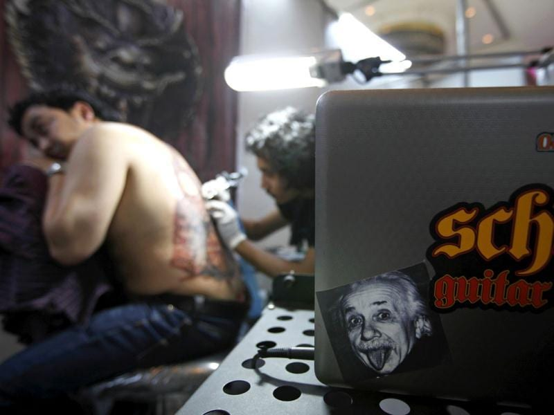 A picture of Albert Einstein is seen as a man gets a tattoo during the 2nd International Nepal Tattoo Convention in Kathmandu. Reuters/Navesh Chitrakar