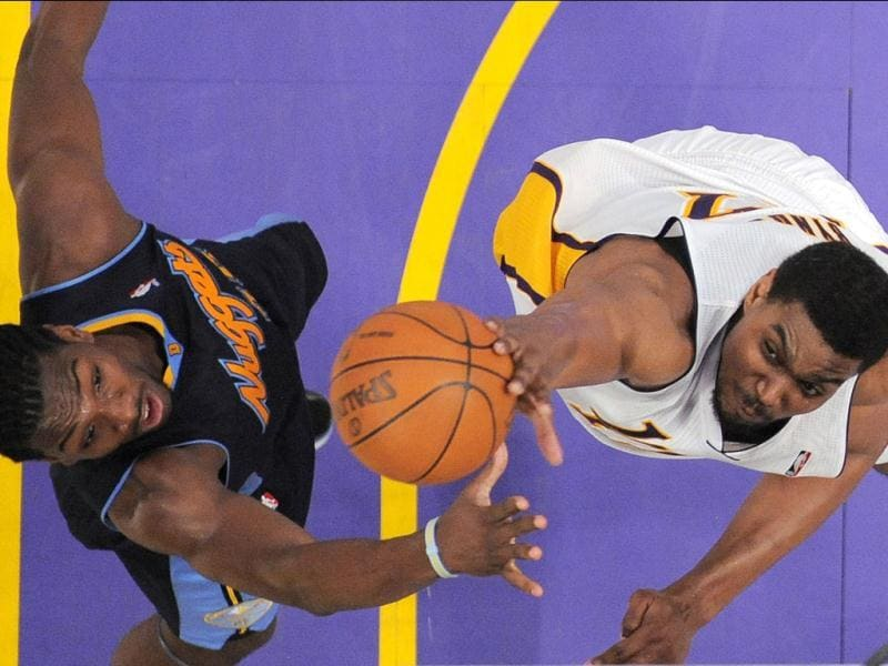 Los Angeles Lakers center Andrew Bynum, right, swats a shot away a shot by Denver Nuggets forward Kenneth Faried during the second half of an NBA first-round playoff basketball game, in Los Angeles. The Lakers won 103-88. (AP Photo)